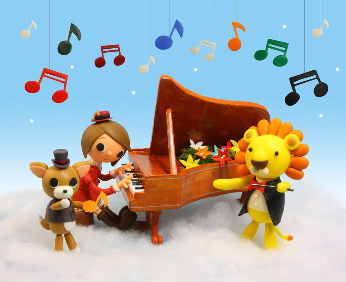 2011年1月号 民主音楽協会コンサートガイド表紙「ライオンの指揮と花のピアノ」